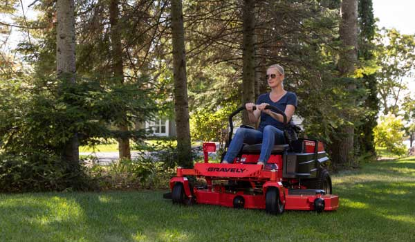 Woman on Lawnmower